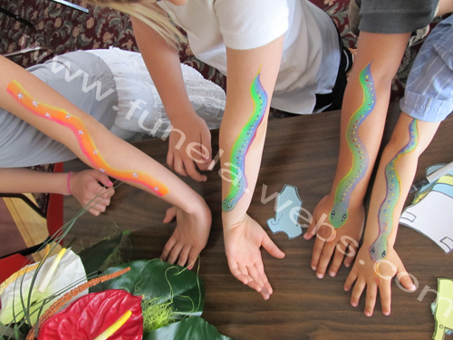 face_painting_arm_design_rainbow_snakes