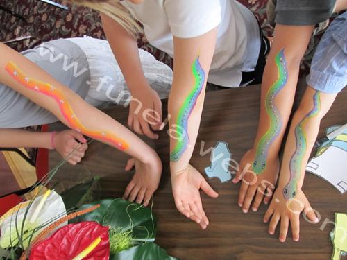 face_painting_arm_design_rainbow_snakes