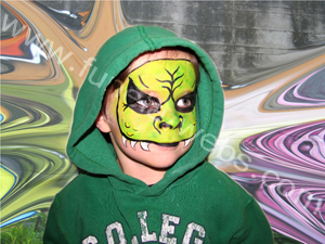 face_painting_boy_design_green_monster_with_black_eyes