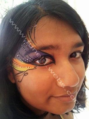 face_painting_teenager_design_blue_yellow_eye_swirls