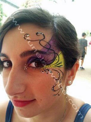 face_painting_girl_design_purple_yellow_eye_swirls