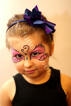 face_painting_pink_butterfly_mask_design