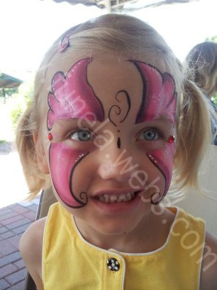 face_painting_pink_butterfly_with_red_jewelry